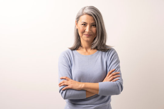 Beautiful grey-haired woman with crossed arms