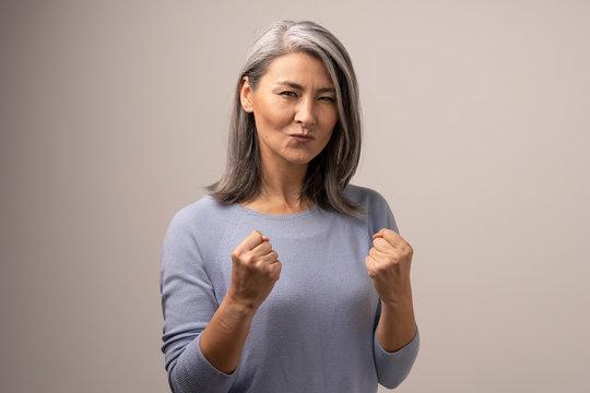Beautiful Asian woman celebrates her victory. Portrait