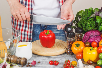 Woman cooks at the kitchen, body part, blurred background