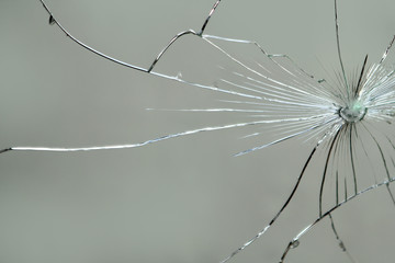 Large cracks on the texture of the broken mirror, glass