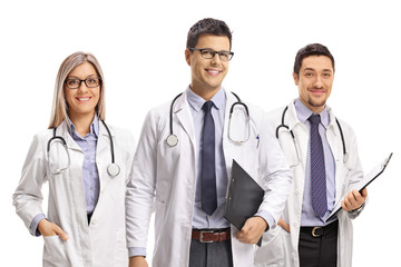 Team of young doctors posing and smiling at the camera