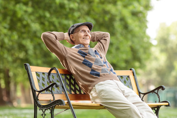 Elderly man enjoying a day on a wooden bench