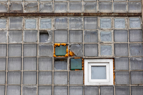 Conceptual picture about software design: Legacy system bug fixing and new feature integration on example of broken windows.