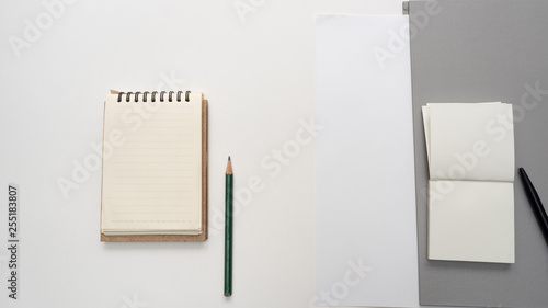 Wall mural Office desk table with Document file and notebook Top view copy space