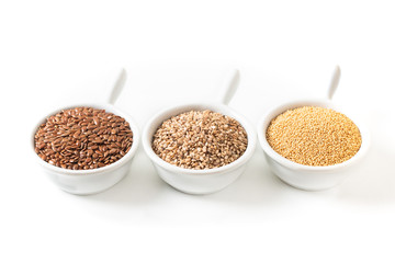 Healthy food ingredients 3 kind of gluten free grains Flax, Amaranth and sesame seeds on white background