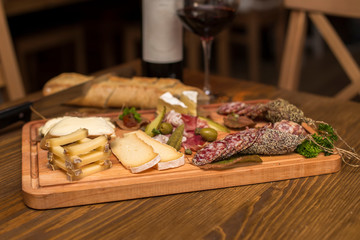 Cheese, sausages and red wine as an appetizer
