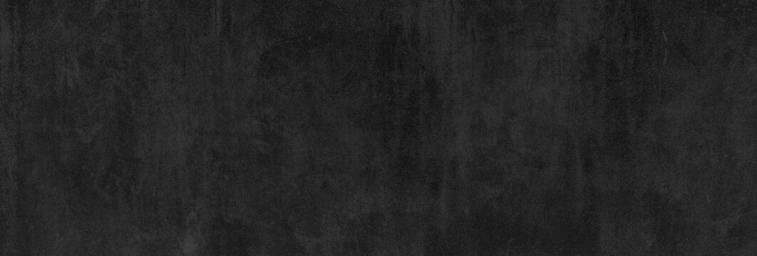 Textur einer fast schwarzen, glatten und alten Betonwand als Hintergrund oder Tafel