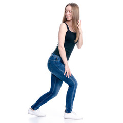 Woman in jeans standing showing pointing holding on white background isolation