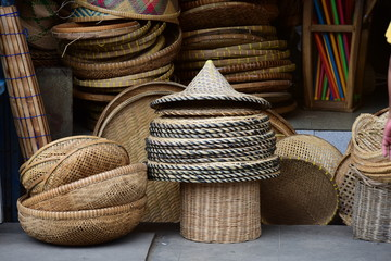 Wicker marketRattan basket.Rattan or bamboo handicraft hand made from natural straw basket.Basket wicker is Thai handmade. it is woven bamboo texture for background and design.Traditional Thai woven s