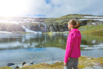Best Norway hike. Cute girl with hiking equipment in the mountains