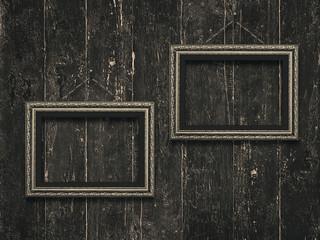 Old wooden frames on vintage  wooden background