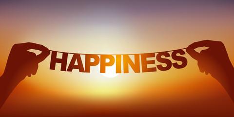 Concept du bien-être et de la joie de partir en vacances, avec deux mains qui tiennent une guirlande sur laquelle est écrit le mot bonheur devant un ciel ensoleillé.