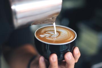 Fototapeta coffee latte art make by barista obraz