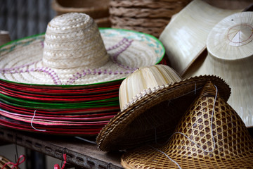 Wicker market.Rattan basket.Rattan or bamboo handicraft hand made from natural straw basket.Basket wicker is Thai handmade. it is woven bamboo texture for background and design.