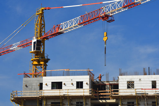 Working construction site  with the high crane and the constructed building .