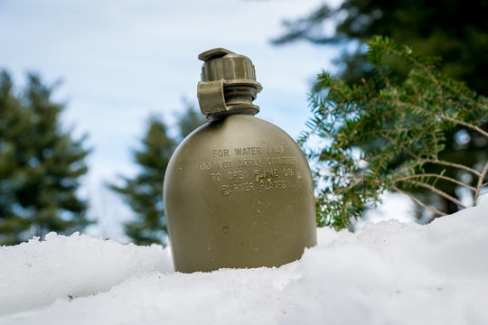 Military plastic canteen in the snow