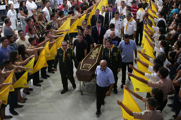 People attend a funeral of the victims killed in a shooting at Raul Brasil school, in Suzano