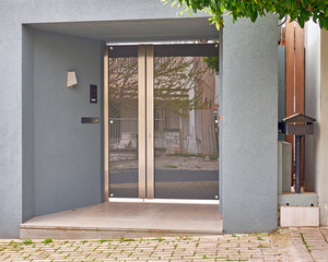 elegant house entrance metal and glass door with letterbox, Athens Greece