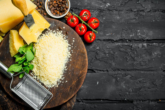 Grated Parmesan cheese with pine nuts, tomatoes and herbs.
