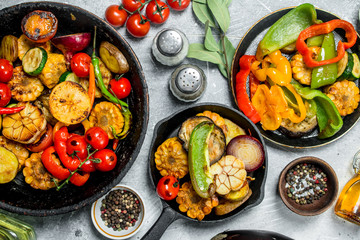 Assortment of grilled vegetables with spices and herbs.