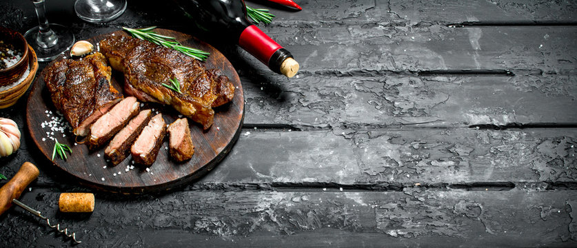 Grilled beef steaks with herbs and red wine.