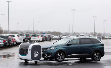 A robot valet named Stan by Stanley Robotics moves a car at Lyon-Saint Exupery Airport
