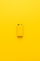blank nine-volt battery on the yellow background