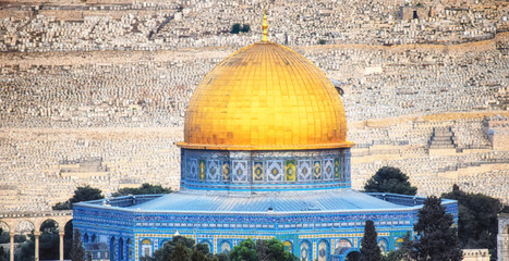 The golden Dome of the Rock set against the silver Dome of the Chain