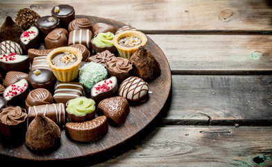 Chocolate sweets on a wooden Board.