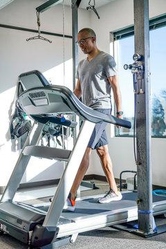 Man walking on treadmill in clinic
