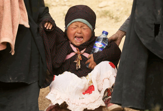 A child cries in the village of Baghouz, Deir Al Zor province