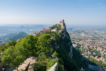 Guaita tower in the fortifications of San Marino on Monte Titano, with the City of San Marino on the left. Wall mural