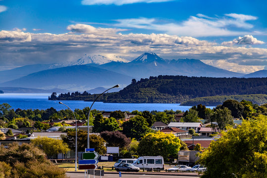 New Zealand, North Island. Taupo town and Lake Taupo, Mt Ngauruhoe, Mt Tongariro and Mt Ruapehu in the background