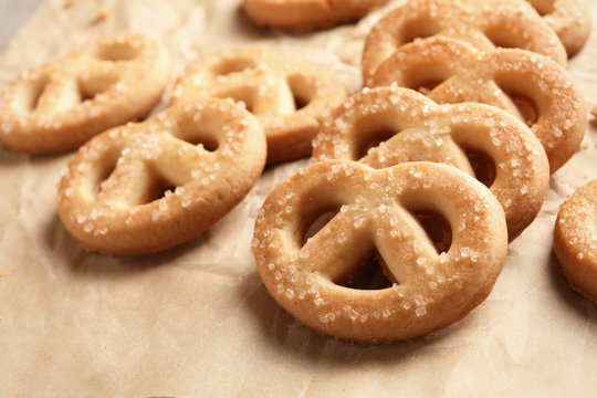 Tasty Danish butter cookies on paper background, closeup