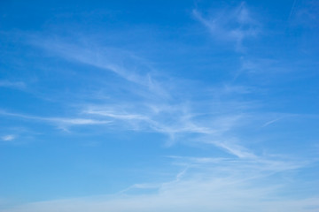 Light white cirrus clouds in the blue sky