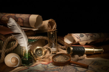 Old maps and vintage objects on a wooden table