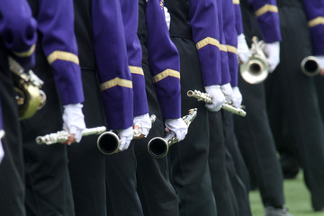 Marching band musicians performing.