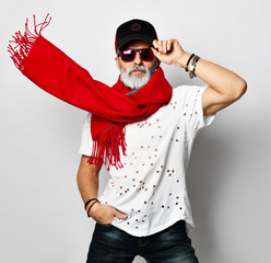 Brutal senior rich man in white fashionable t-shirt cap and long red scarf stylish fashionable men
