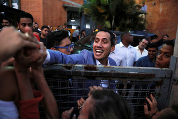 Venezuelan opposition leader Juan Guaido, who many nations have recognized as the country's rightful interim ruler, leaves after a rally against Venezuelan President Nicolas Maduro's government in Caracas