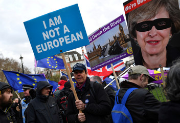 Pro-Brexit protester holds up a sign outside the Houses of Parliament in London