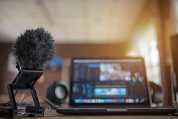 Blurred laptop desktop office content creator or vlog editor Wall mural