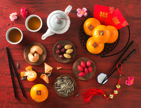 Text appear in image: Spring and Prosperity. Flat lay Chinese new year still life.