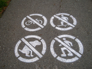 no bicycle skateboard inline skate roller blade dog poo sign on the road