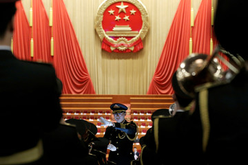 Military band members rehearse before the closing session of the National People's Congress (NPC) at the Great Hall of the People in Beijing