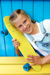 Нappy, laughing child wearing cool fashion clothing posing wit