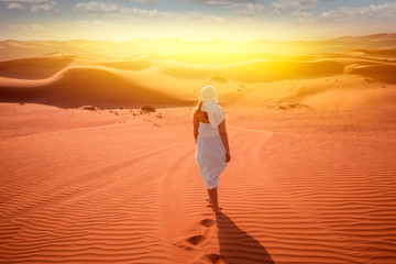 woman in beduin dress in desert
