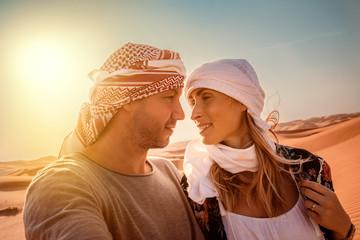 travel couple in arabian desert