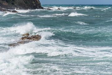 Waves Crashing on Rocks on the Southern Italian Mediterranean Coast