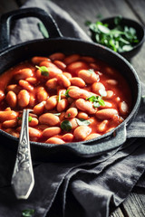 Delicious baked beans made of fresh tomatoes and herbs