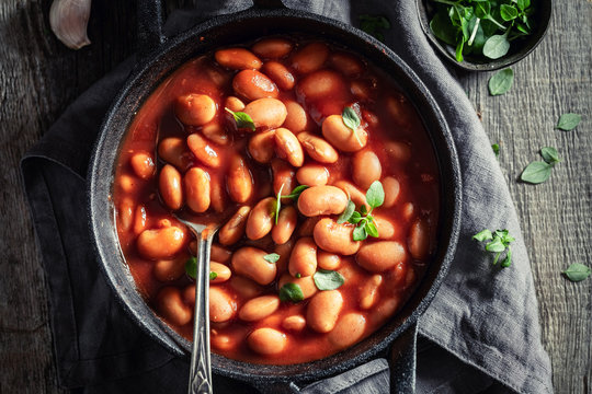 Tasty baked beans with garlic and fresh tomatoes